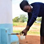 The Water Project: Kikuswi Secondary School -  Fetching Water At New Tank