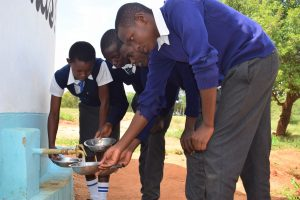 The Water Project:  Fetching Water At New Tank