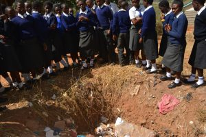 The Water Project:  Students Learn About Proper Waste Management