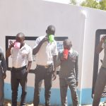 The Water Project: AIC Kyome Boys' Secondary School -  Drinking Water From The Tank