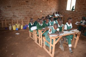 The Water Project:  Students In Class With Their Containers Of Water In The Back