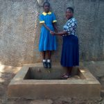 The Water Project: Munyanda Primary School -  Student Keilla Lopez With Field Officer Betty