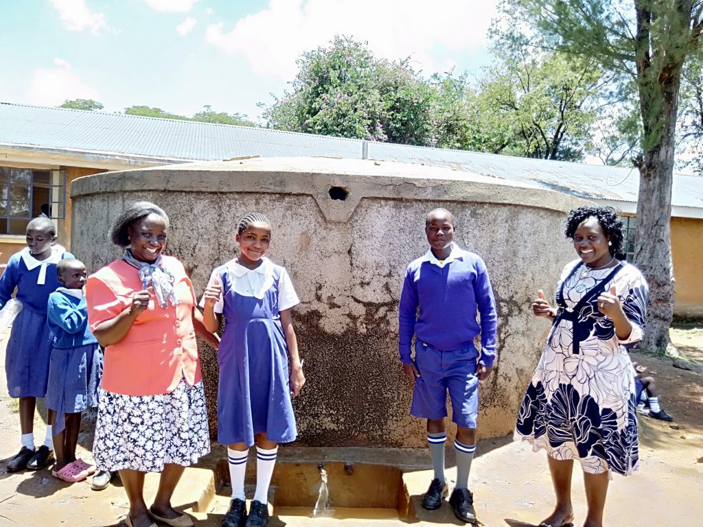 The Water Project : 1-kenya18007-senior-teacher-pamela-olwanda-pupils-stephanie-and-juma-and-wash-staff-karen-maruti