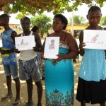 The Water Project: Kasongha, 8 BB Kamara Street -  Community Members Hold Training Materials