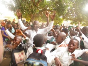 The Water Project:  Head Teacher Sulaiman Ccelebrating With Students