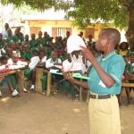The Water Project: DEC Makassa Primary School -  Student Demonstrates Teech Brushing