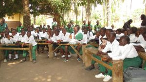 The Water Project:  Students Sit During Training