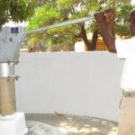 The Water Project: DEC Makassa Primary School -  The Head Teacher Pumps Water