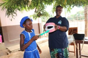 The Water Project:  A Student Helps In The Toothbrushing Demonstration