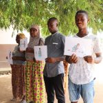 The Water Project: SLMB Primary School -  Holding Training Materials