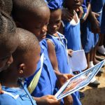 The Water Project: SLMB Primary School -  Pupils Looking At Jediah Ballard Picrures