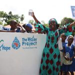 The Water Project: Mahera, SLMB Primary School -  School Head Teacher Celebrating Clean Reliable Drinking Water