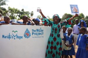The Water Project:  School Head Teacher Celebrating Clean Reliable Drinking Water