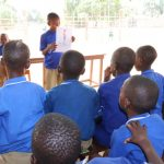 The Water Project: SLMB Primary School -  Students Listen At The Training