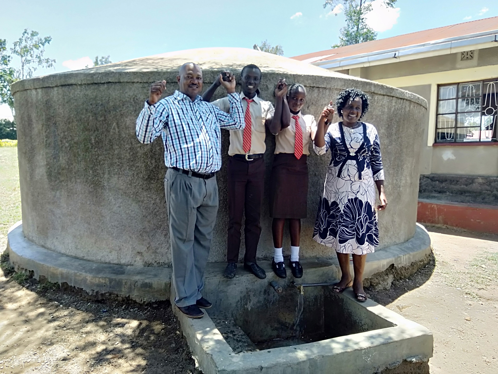 The Water Project : the-principal-mr-were-webukha-linda-onyango-saniation-secretary-fabian-khakame-the-saniation-prefect-and-karen-maruti-wash-staff