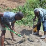 The Water Project: Mwichina Community, Shihunwa Spring -  Mixing Cement