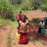 The Water Project: Emulembo Community, Gideon Spring -  Carrying Water