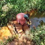 The Water Project: Emulembo Community, Gideon Spring -  Fetching Water