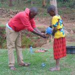 The Water Project: Mwichina Community, Shihunwa Spring -  Handwashing Demonstration