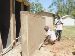 The Water Project:  Plastering Latrine Wall