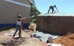 The Water Project:  Teamwork Makes Cement Fly