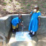 The Water Project: Emukangu Community, Okhaso Spring -  Running Water