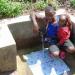 The Water Project: Mwichina Community, Shihunwa Spring -  All Ages Enjoy The Spring