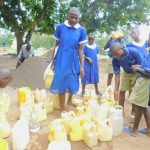 The Water Project: Eshiakhulo Primary School -  Students Bring Water For Construction