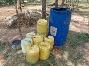 The Water Project:  Collecting Materials Including Water