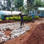 The Water Project: Hombala Secondary School -  Adding Stones