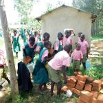 The Water Project: Mukhweya Primary School -  Students Bringing Bricks