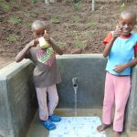 The Water Project: Emukangu Community, Okhaso Spring -  Thumbs Up For Flowing Water
