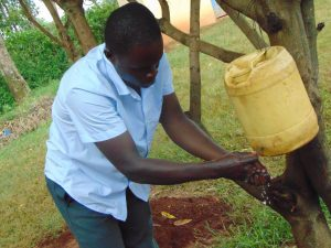 The Water Project:  Using A Tippy Tap