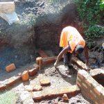 The Water Project: Emukangu Community, Okhaso Spring -  Bricklaying Begins