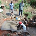 The Water Project: Mwichina Community, Shihunwa Spring -  Adding Cement