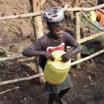 The Water Project: Ataku Community, Ngache Spring -  Mounting Her Water