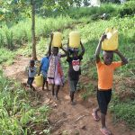 The Water Project: Ataku Community, Ngache Spring -  Carrying Spring Water Home