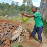 The Water Project: Dr. Gimose Secondary School -  Delivering Stones