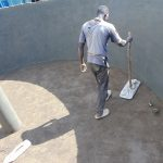 The Water Project: Hombala Secondary School -  Tamping Down Cement