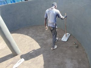 The Water Project:  Tamping Down Cement