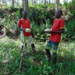 The Water Project: Emukangu Community, Okhaso Spring -  Delivering Food To The Artisan