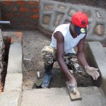 The Water Project: Mwichina Community, Shihunwa Spring -  Cementing The Stairs