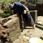 The Water Project: Ataku Community, Ngache Spring -  Wall Construction