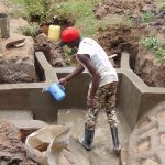The Water Project: Mwichina Community, Shihunwa Spring -  Water To Smooth Cement