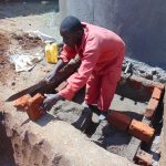 The Water Project: Mukhweya Primary School -  Cutting Bricks For The Tap Area
