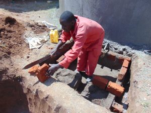 The Water Project:  Cutting Bricks For The Tap Area