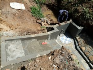 The Water Project:  Backfilling The Spring Box