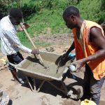 The Water Project: Emukangu Community, Okhaso Spring -  Mixing Cement
