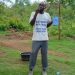 The Water Project: Mwichina Community, Shihunwa Spring -  Participant Mr Sevelinus Brushes His Teeth