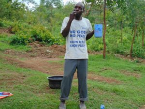 The Water Project:  Participant Mr Sevelinus Brushes His Teeth